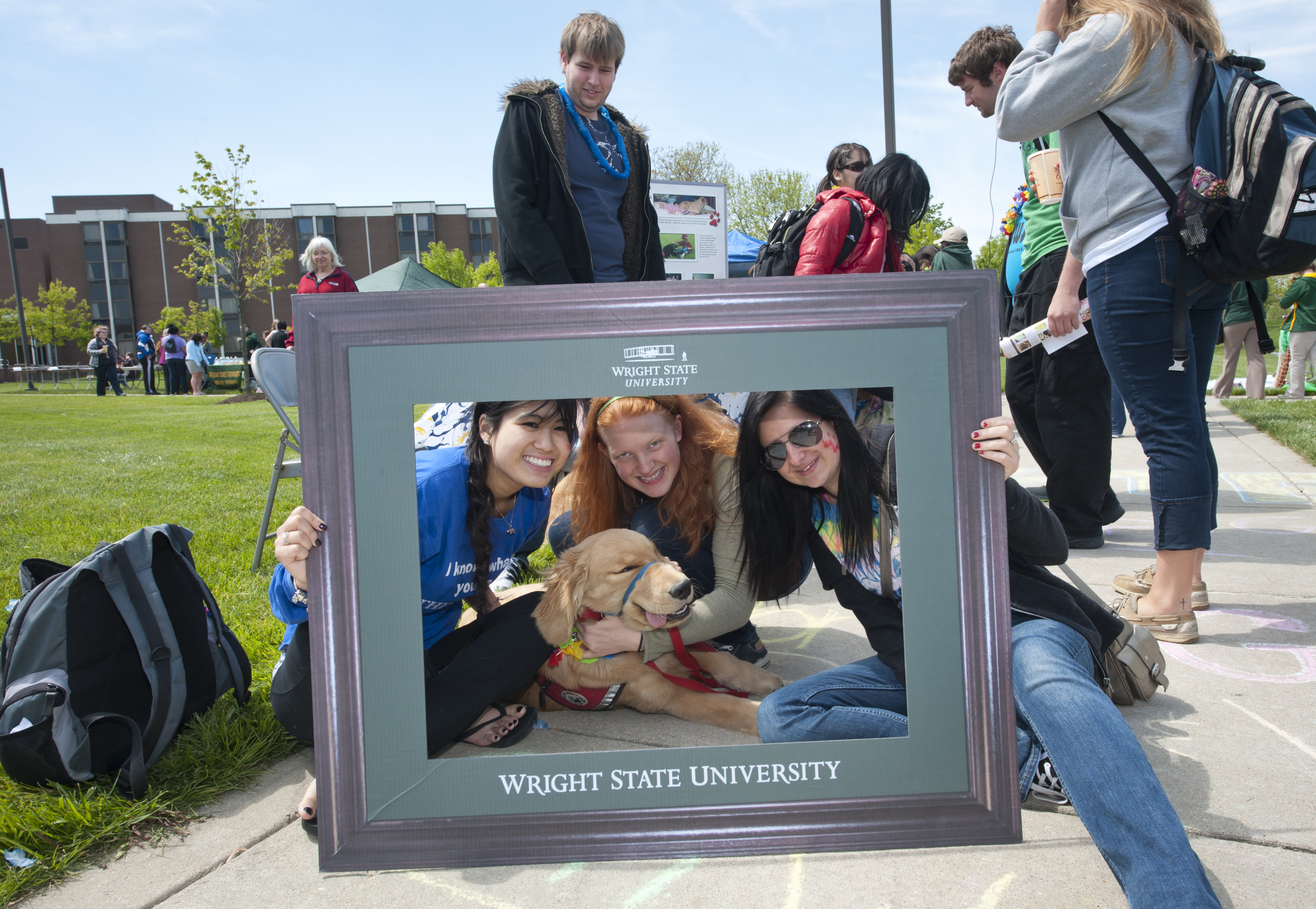 Photo of student posing with over-sized picture frame.