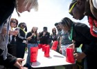 Photo of students playing flip-cup.