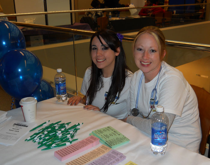 Photo of two students at a table.