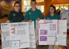Photo of three students with poster presentations