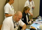 Photo of students doing health screenings