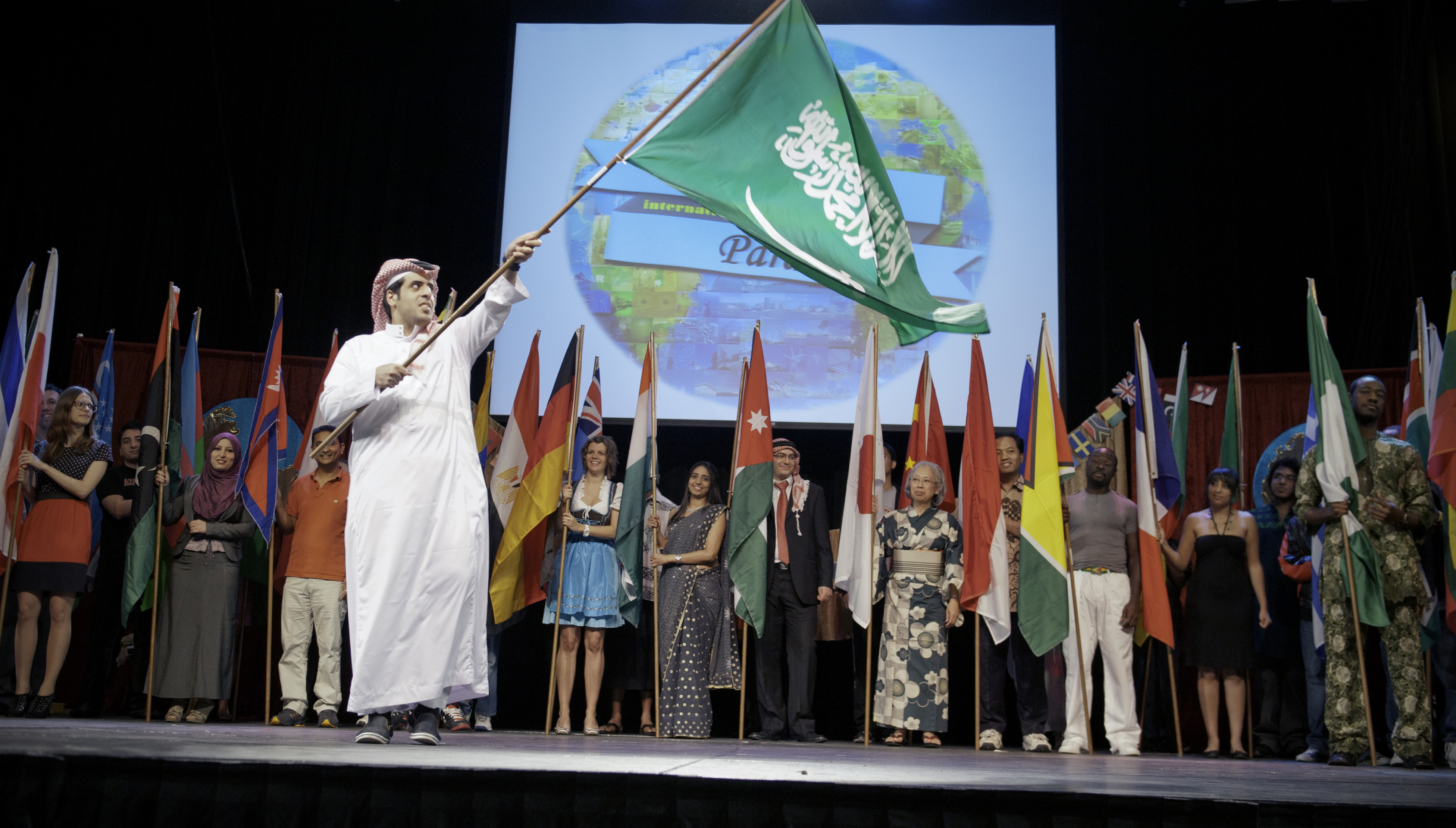 A student from Saudi Arabia waves the flag from his homeland.