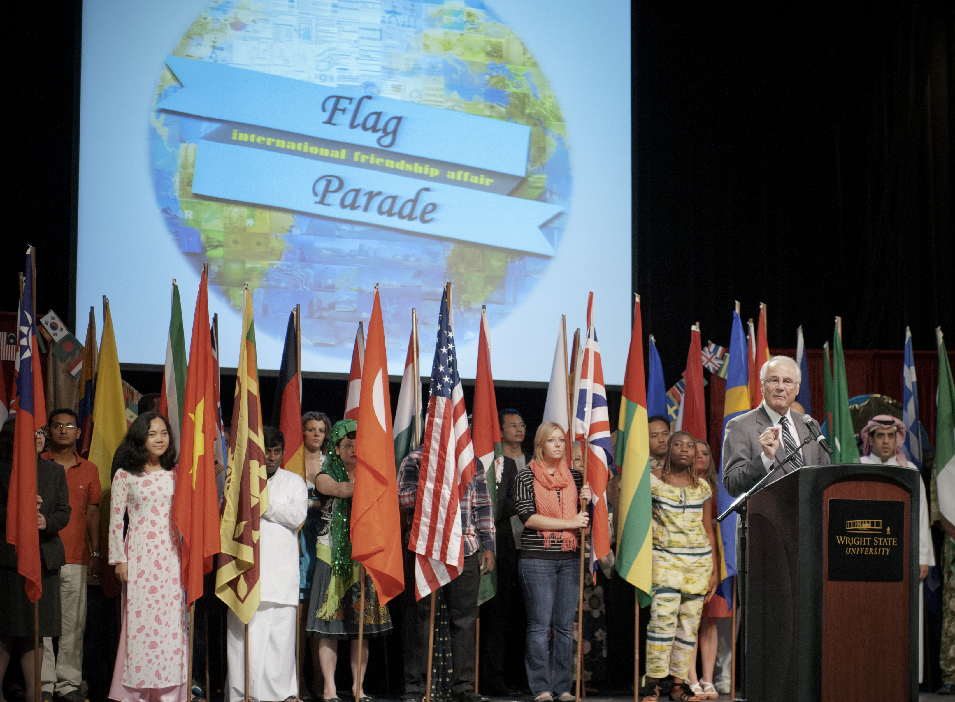Photo of students holding the flags representing the 62 countries which Wright Stat students call home.