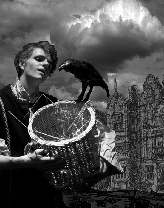 Photo of a boy in medieval clothes with a basket and a crow.