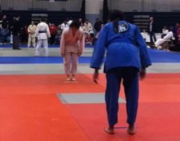 Photo of two people preparing to fight in a judo tournament.