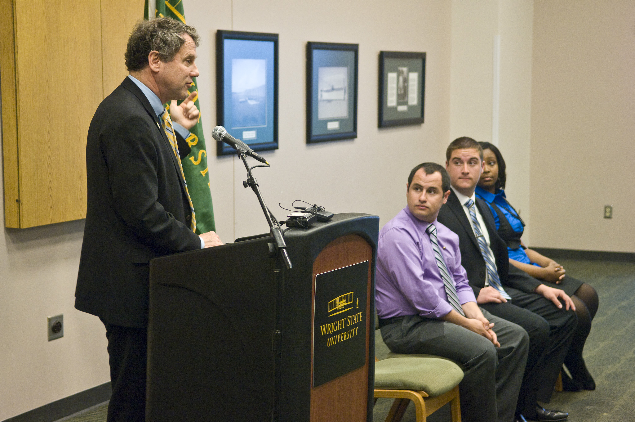 Photo of U.S. Senator Sherrod Brown and three Wright State University students who also spoke at the news conference.