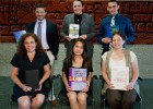 Photos of the six top scholars with their books.