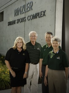 Photo of Wright State president David R. Hopkins and his wife Angelia with Wright State's fourth president Paige E. Mulhollan and his wife Mary Bess.