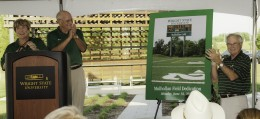 Photo of Wright State President David R. Hopkins revealing that the soccer field will now be named Mulhollan Field.