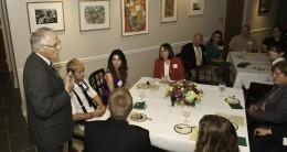 Photo of Wright State President David R. Hopkins speaking with students at Rockafiled House