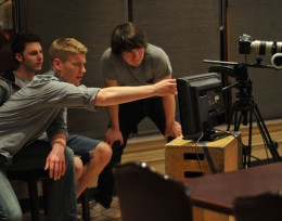 Photo of student filmmakers with a camera