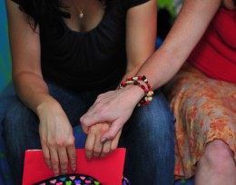 Photo of two women holding hands