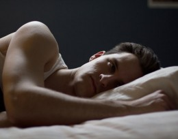 Photo of a man laying on a bed