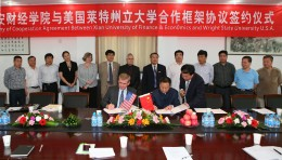 (Center left) Wright State Provost Steven Angle signing an agreement with Jian Hu, president of of Xi'an University of Finance and Economics.
