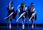 Photo of three dancers in chairs