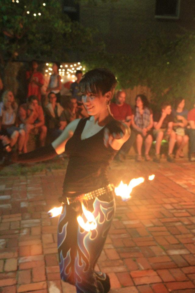 Photo of Wright State recent graduate Lara Donnelly fire dancing.