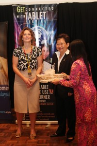 Photo of Sue Polanka receiving a gift