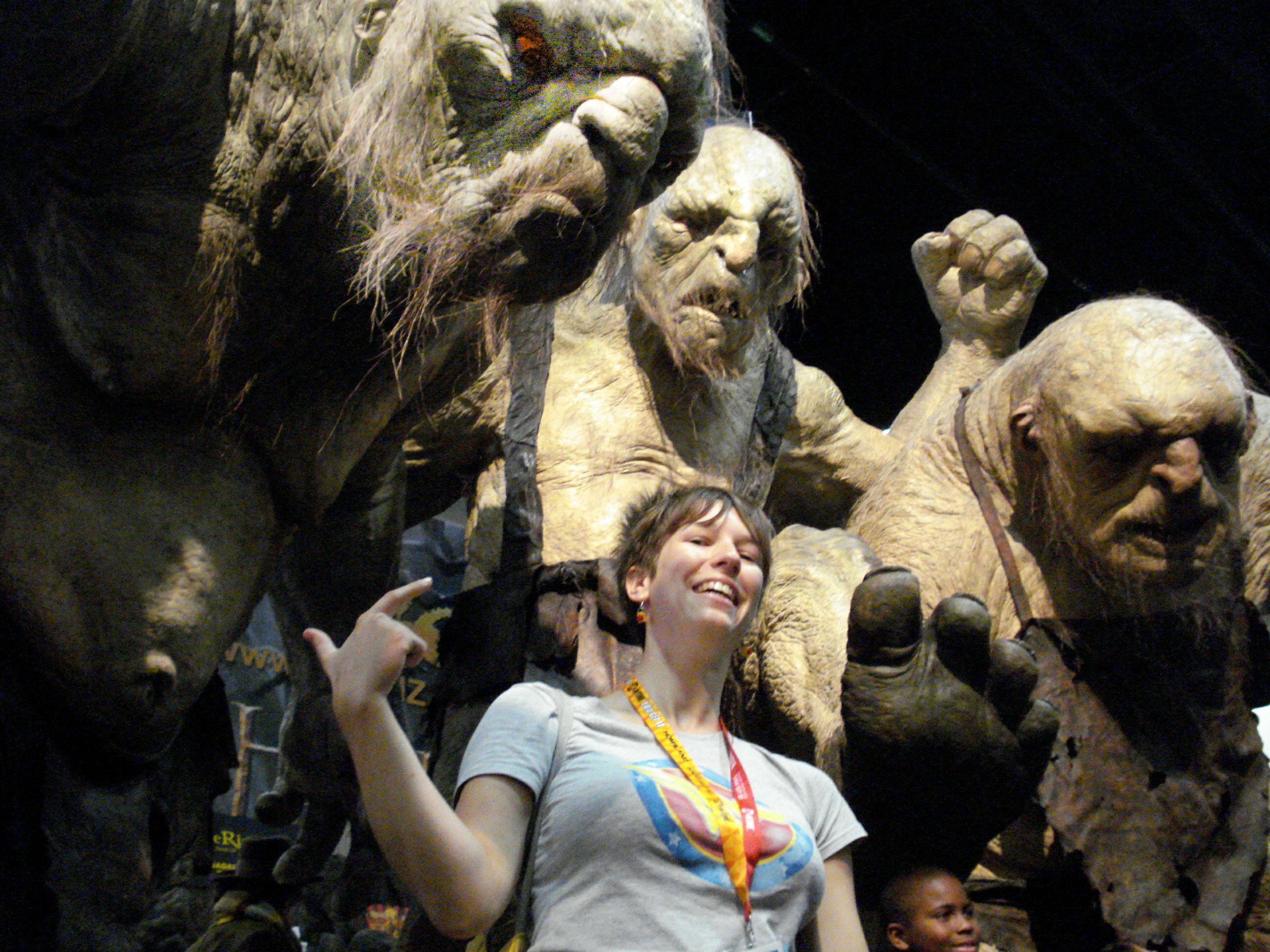 Photo of Lara Donnelly posing for a picture with some life-size monsters at the San Diego Comic Convention.