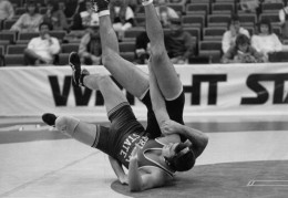 Photo of McClintock as a Wright State wrestler grappling on the mat.