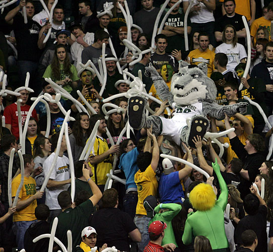Photo of Rowdr Raider crowd surfing among basketball fans at a Raiders basketball game at the Wright State Nutter Center.