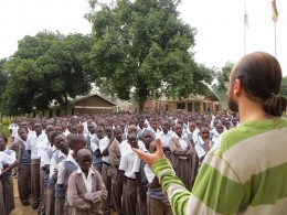 Photo of Engineering professor Nasser Kashou addressing students in Uganda