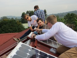 Photo of Wright State engineering students installing solar panels at the Ugandan clinic.
