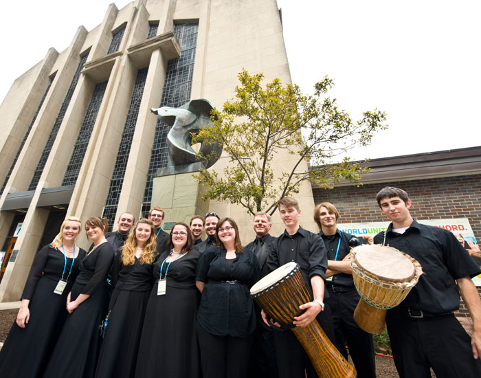 Photo of some members of the Collegiate Chorale outside the Christ Church Cathedral.