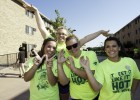 Student volunteers made WSU hand signals to show their pride.