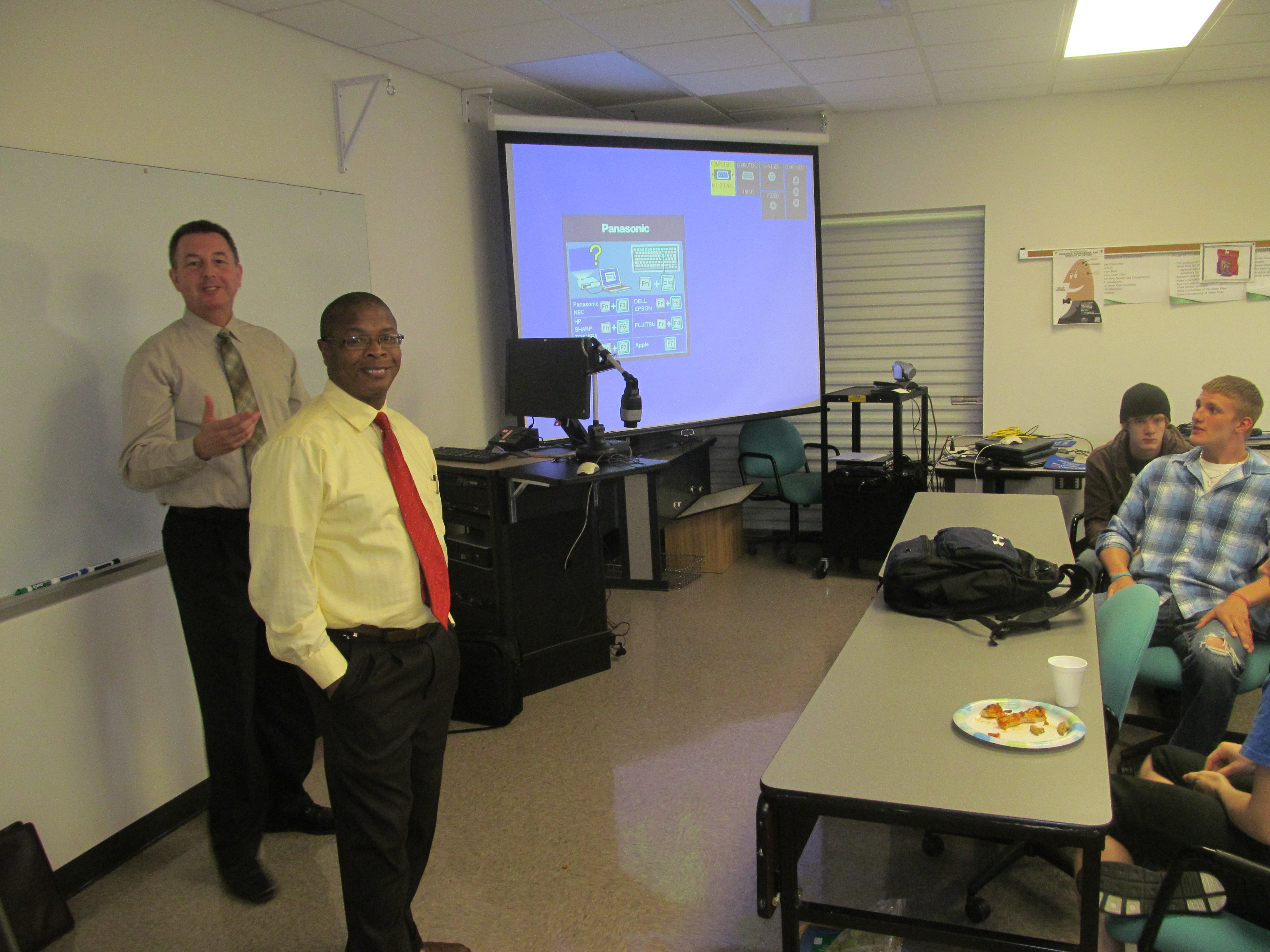 Photo of Lake Campus Engineering Director Ruby Mawasha and Crown employee Jeff Davis during a presentation by Davis about software used by Crown Equipment.