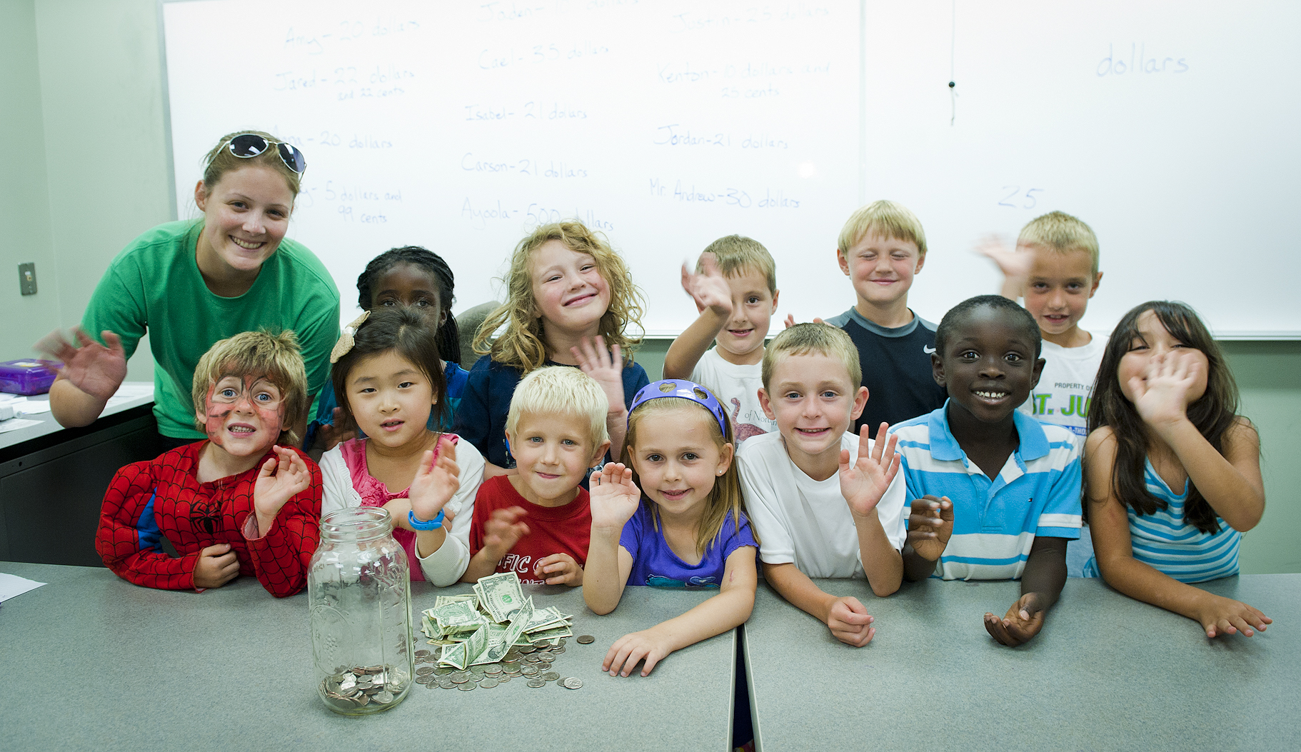 Photo of students in Miss Kelly's Lemonade Stand class. Campers learned about counting the money they earn selling lemonade. All proceeds were donated to the Humane Society.
