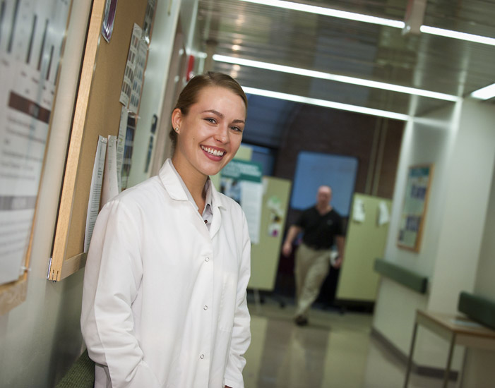 Photo of Wright State biology major Theresa Fennell outside the lab where she works