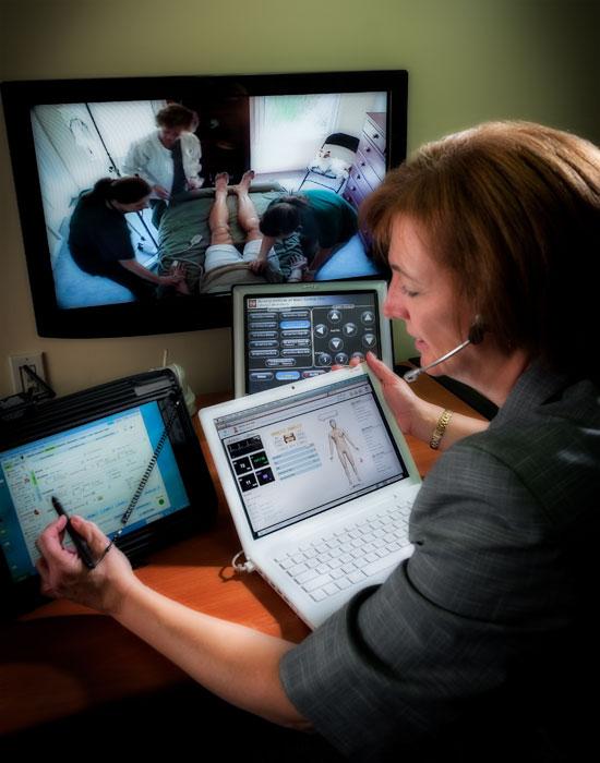 Photo of someone controling patient simulators.