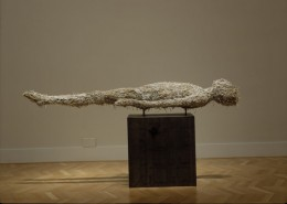 Photo of a sculpture of a person lying down