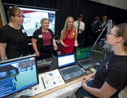 Photo of Wright State students showing their project at the Summer-at-the-Edge Open House