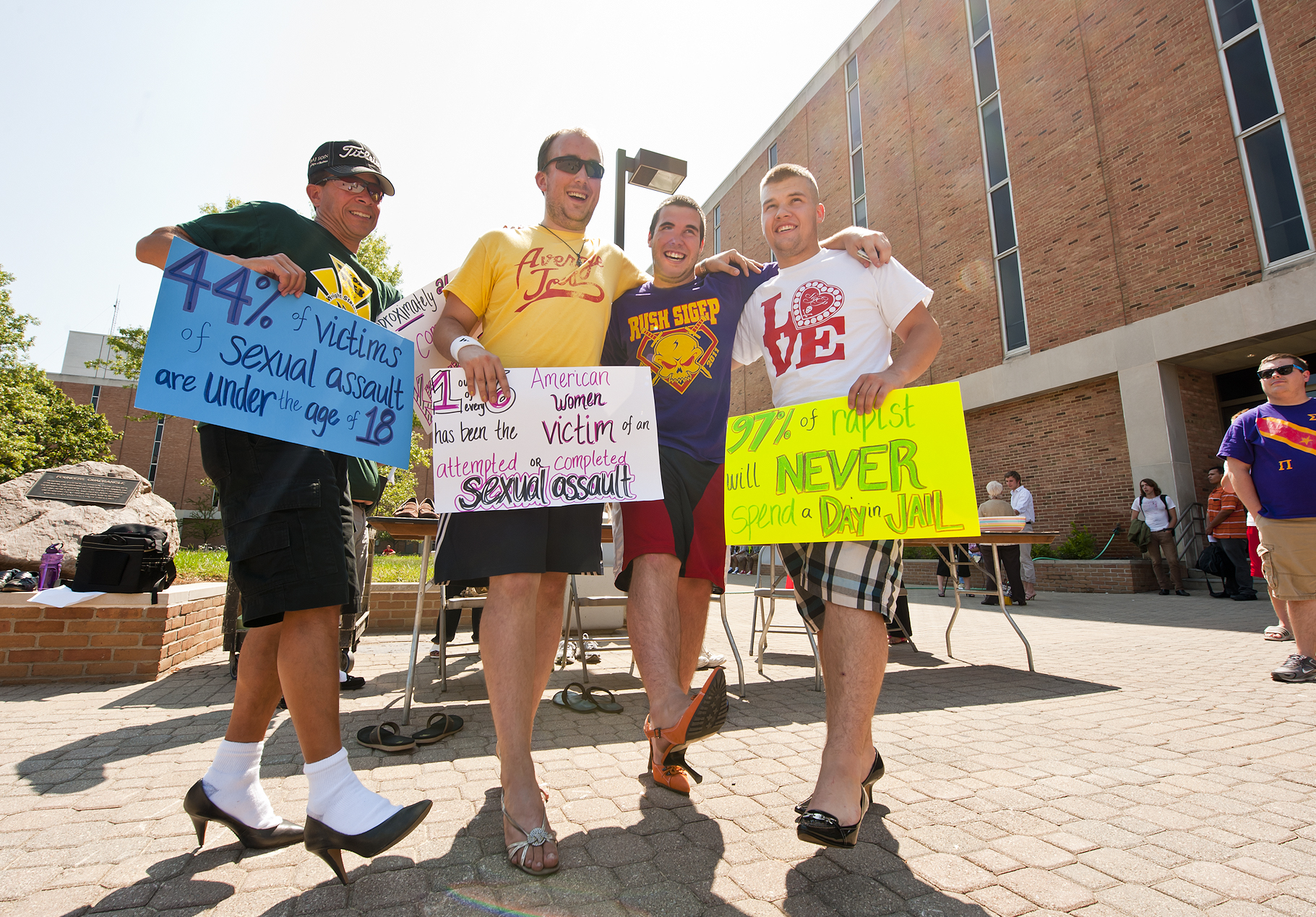 "Male students were ""striding in stilettos"" during Welcome Week at Wright State.  The men walked a mile around the quad in high-heel shoes and green-and-gold Raider attire. Donations for victims of abuse were collected during the Aug. 30 event."