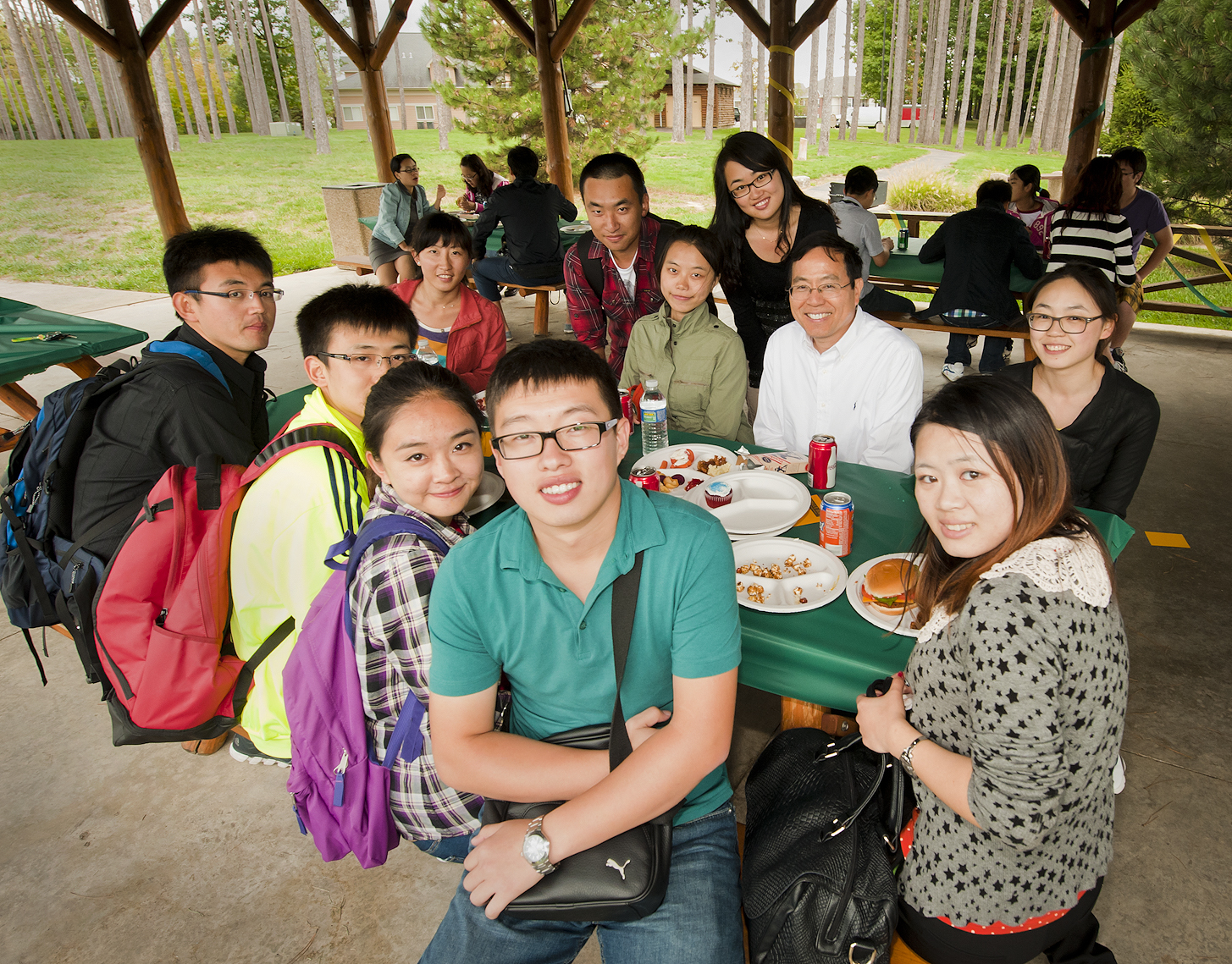 Photo of Chinese students at a picnic table
