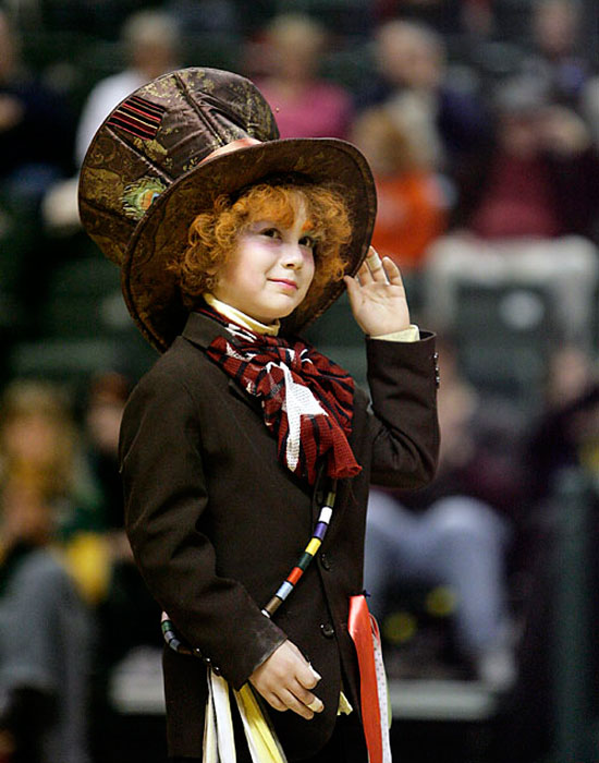 "Photo of a child dressed as the Mad Hatter from ""Alice in Wonderland."""
