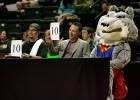 Photo of Rowdy as a judge in a Superman costume.