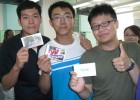 Dalian students display flashcards they're using to learn English.