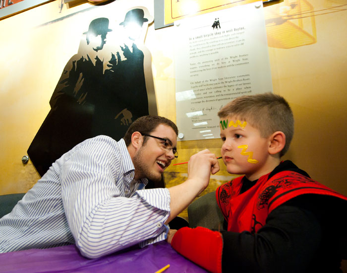 Photo of a child getting his face painted at Multicultural Halloween.