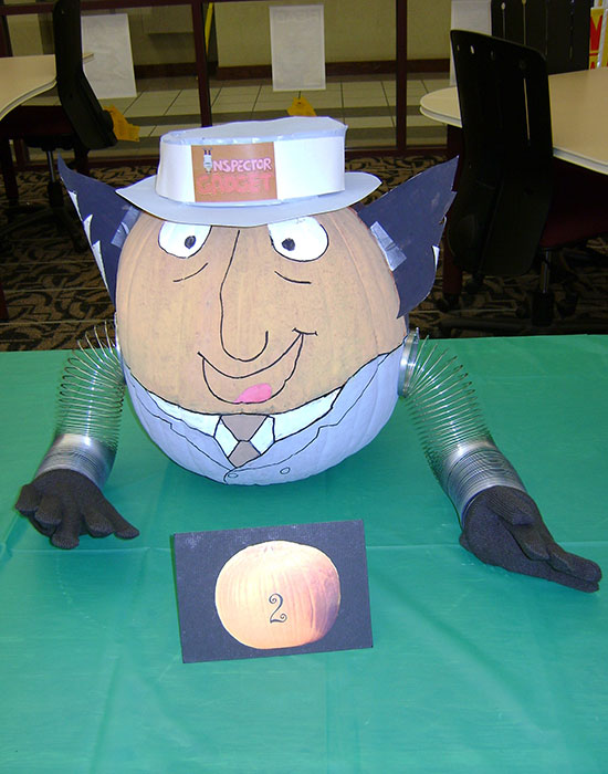 Photo of a pumpkin dressed as Inspector Gadget