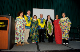 Photo of Wright State Presidnet David R. Hopkins and Immersion Day participants on stage dressed in ethnic gowns.