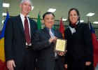 Photo of George Huang receiving his award