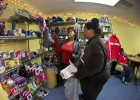 A volunteer at the Toy Cottage in Montgomery County helps a guest pick out some gifts for her family.