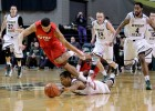 Sophomore guard Reggie Arcenaux dives after a loose ball in the Raiders Jan. 30 loss to Detroit.