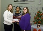Photo of Greene County Children Services accepting check. Middle, Kikia Bibbs, right, Tasha Ertel