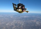 Photo of Wright State&#039;s Herb Dregalla (in yellow suit) skydiving with an Army Golden Knight