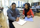 Photo of Dontaé Evans getting advice from his study coach, Daniella Marcano.
