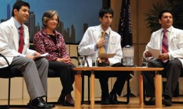 Photo of Lakshman Swamy, Avash Kalra, and Shamie Das (white coats, l-r) interview U.S. Rep. Jan Schakowsky during her keynote address at an AMSA conference in Chicago.