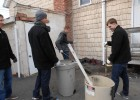 Zach Rapp, David Arquilla, Ryan Dobie and Adam Stephens cleaned up outside the church.